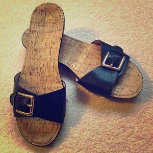 Restricted buckle slide sandals
